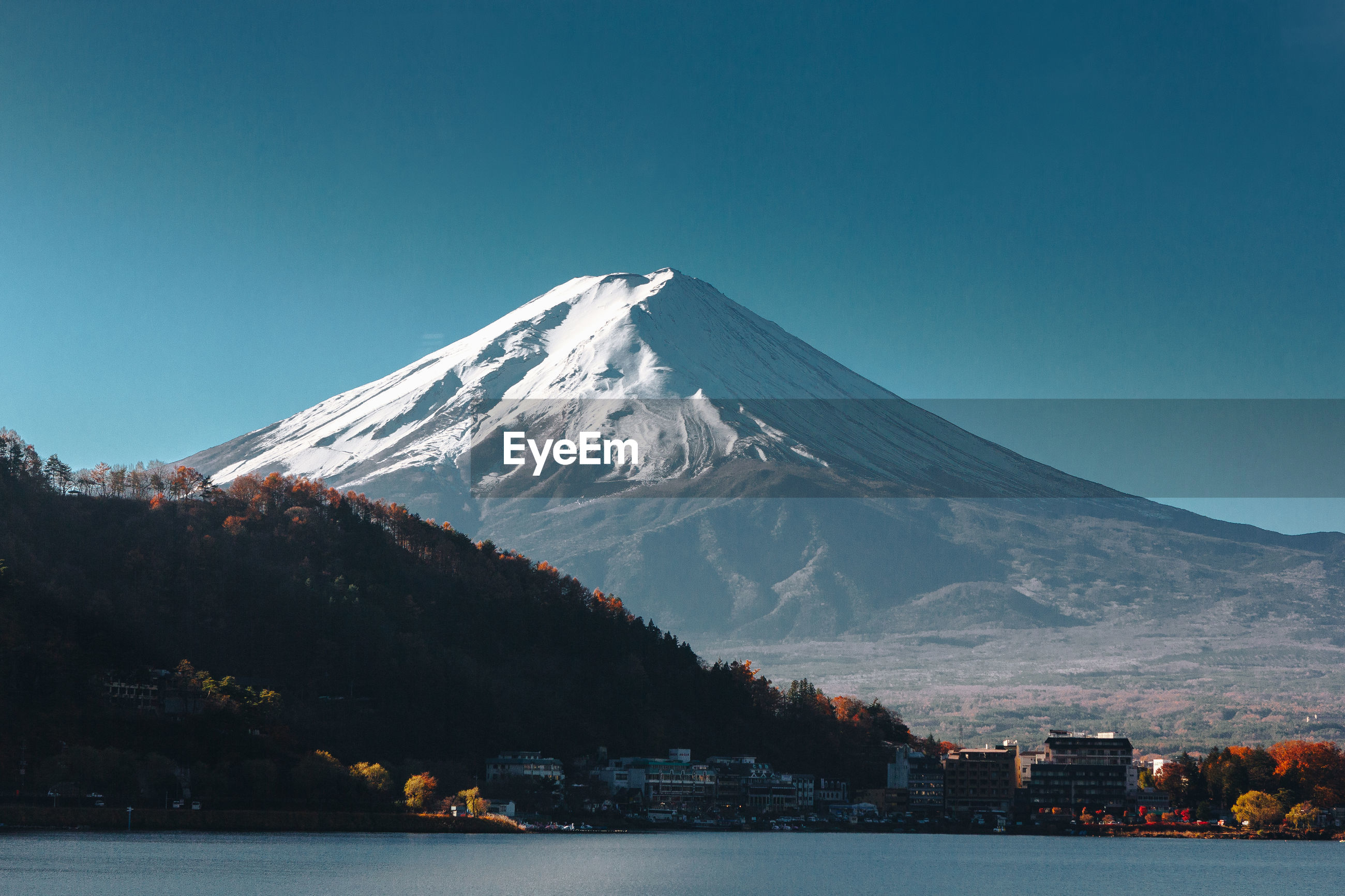 SNOWCAPPED MOUNTAINS AGAINST CLEAR SKY