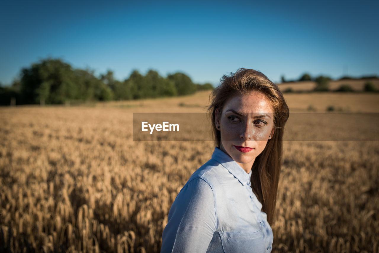 Beautiful Woman Looking Away While Wheat Field