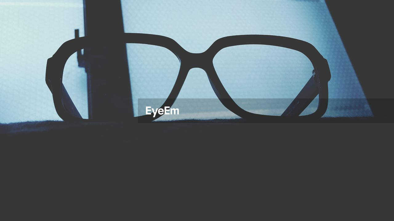 eyeglasses, close-up, no people, day, indoors, sky