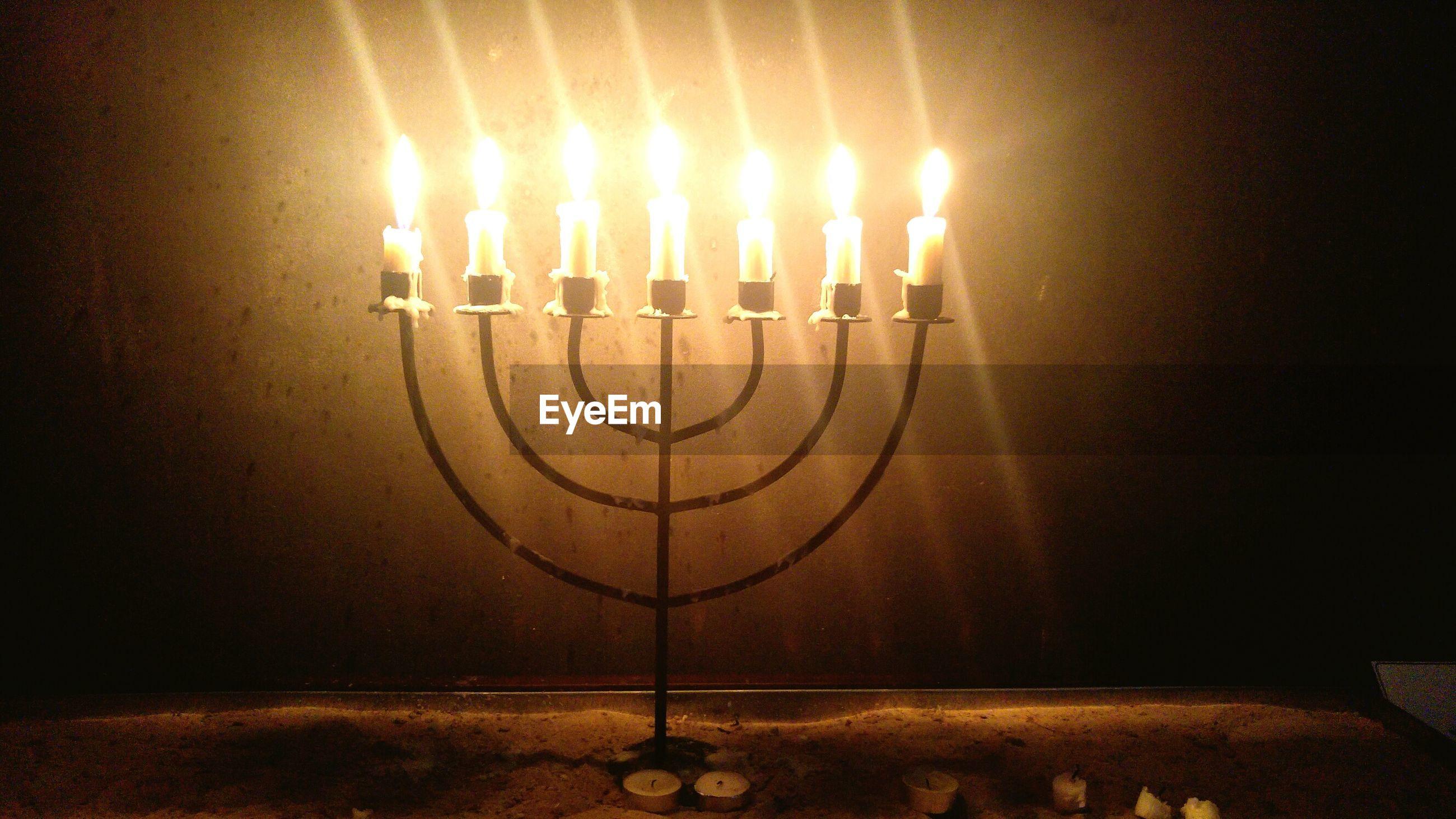 ILLUMINATED LAMP ON TABLE AT NIGHT