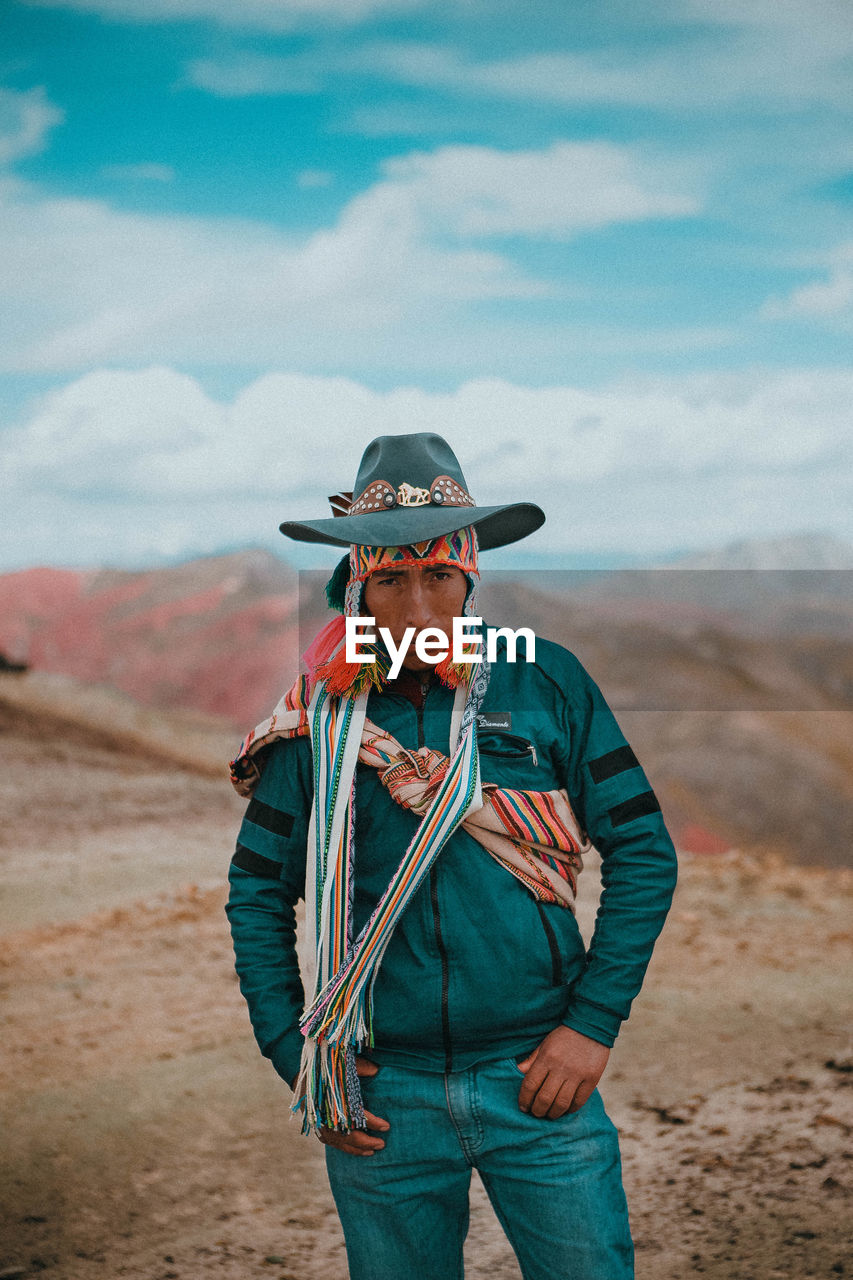 one person, front view, clothing, standing, real people, land, leisure activity, sky, men, cloud - sky, adult, focus on foreground, lifestyles, nature, day, portrait, looking at camera, males, outdoors, mature men