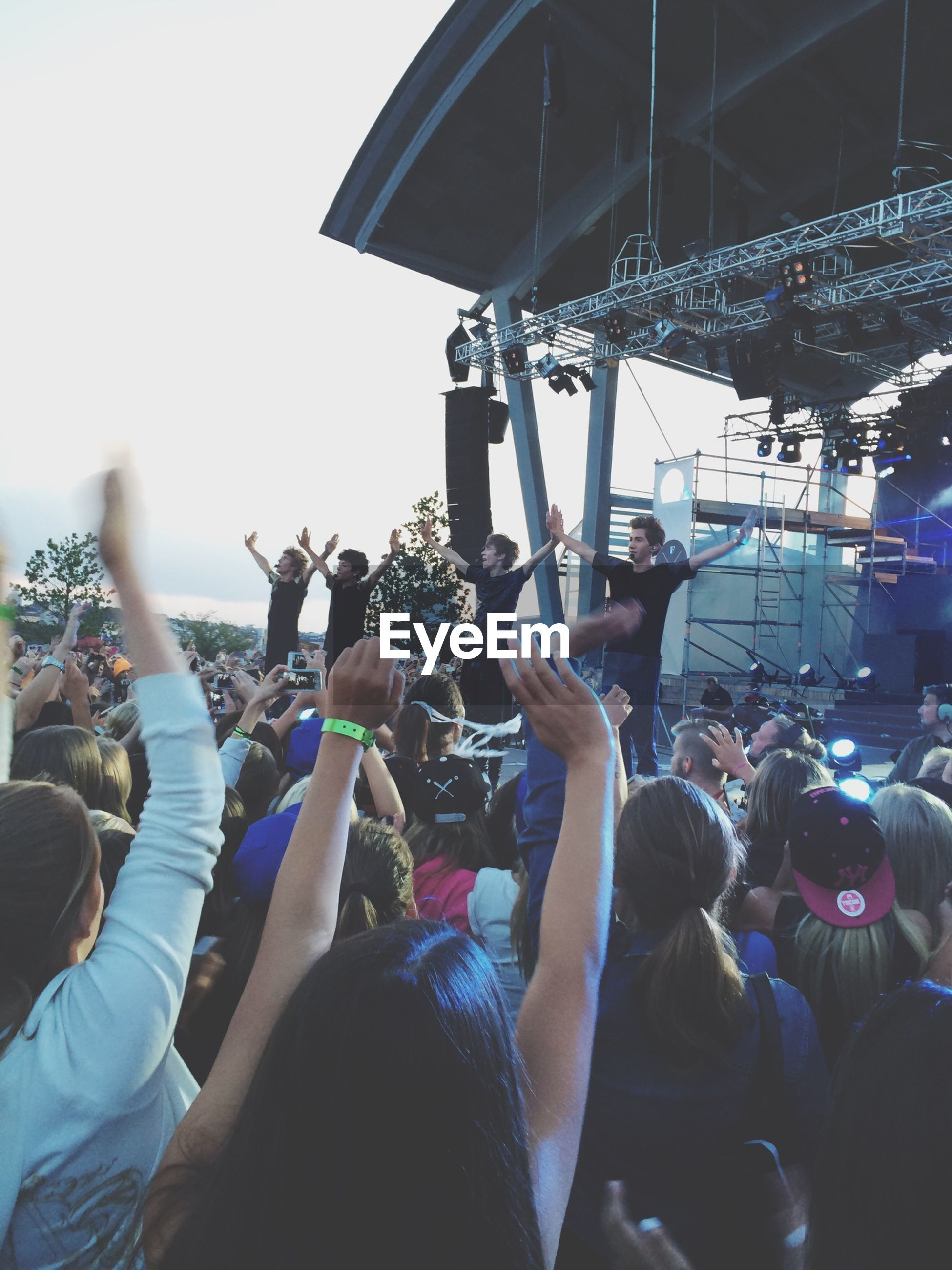 large group of people, lifestyles, men, leisure activity, crowd, person, arts culture and entertainment, togetherness, music, enjoyment, fun, event, performance, holding, celebration, casual clothing, spectator, occupation