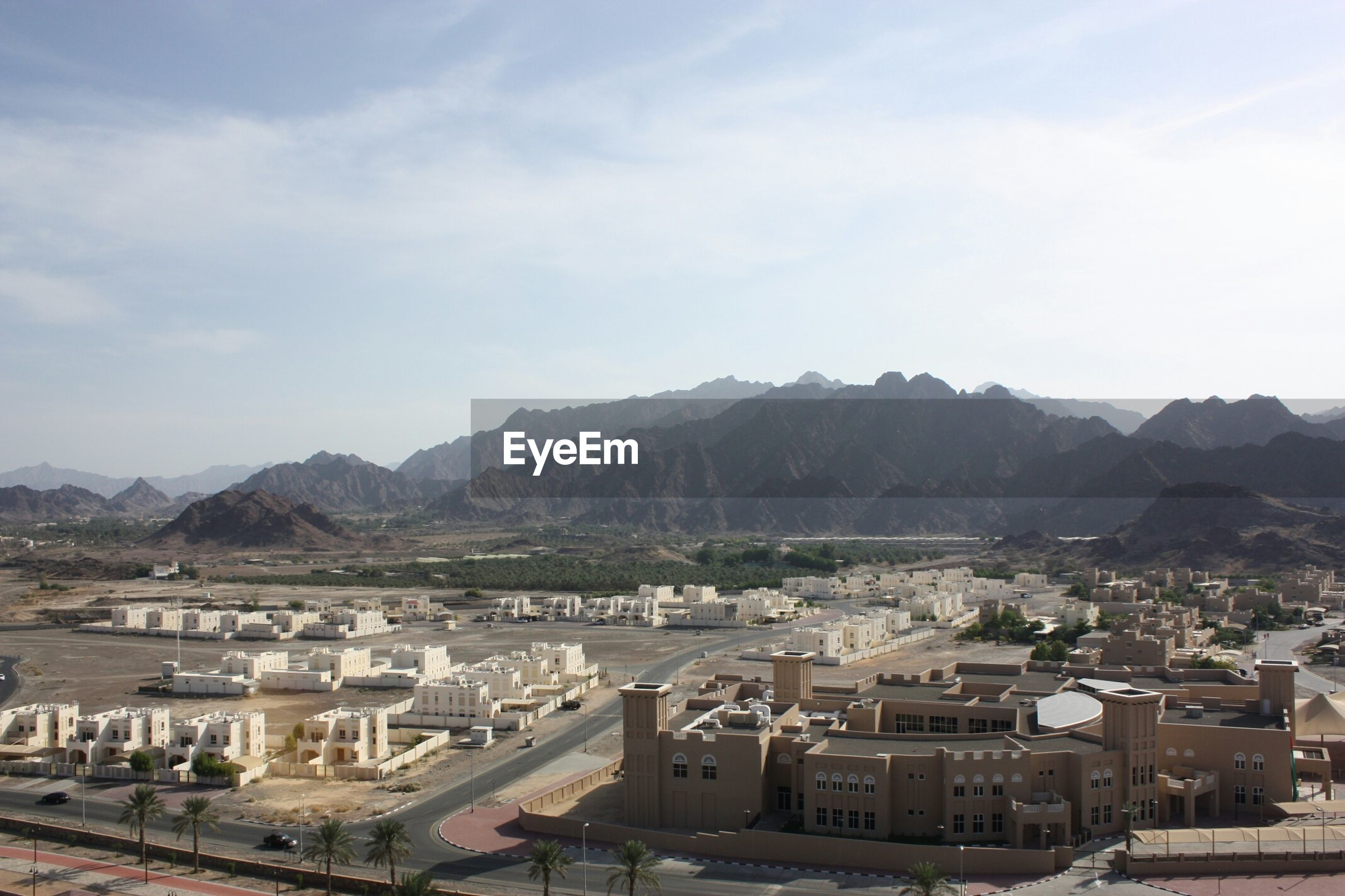 High angle view of residential district by mountains