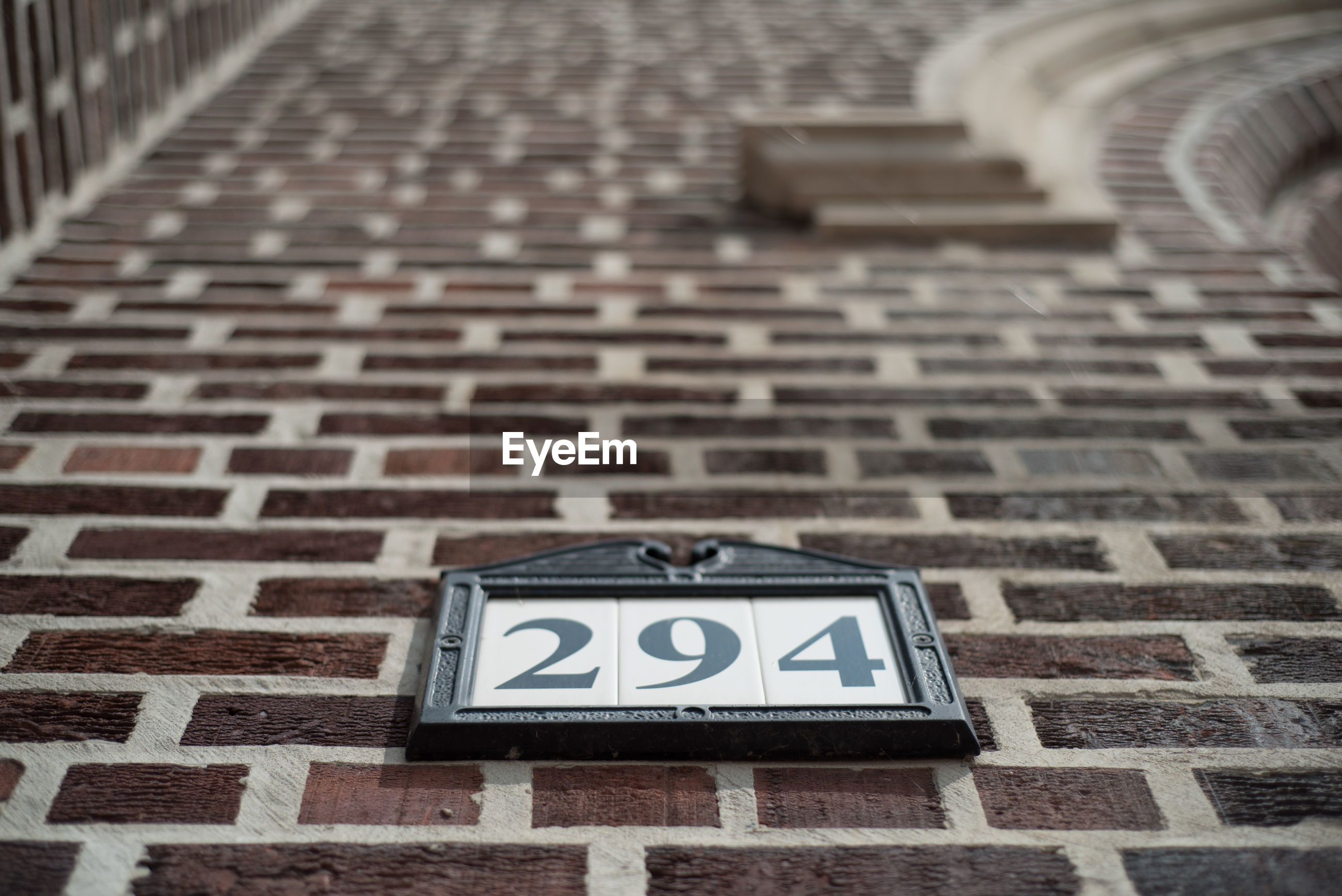 Low angle view of number on building wall