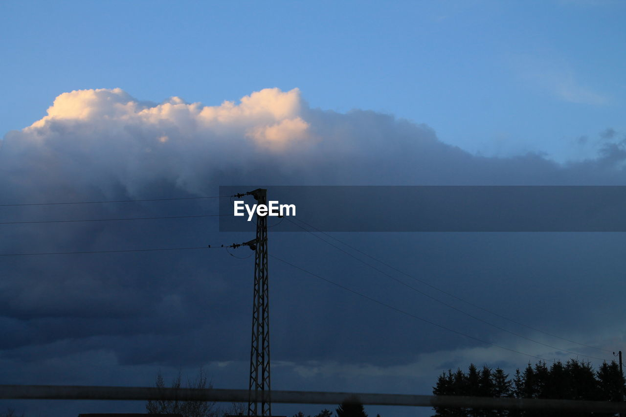 Electricity Pole At Dusk