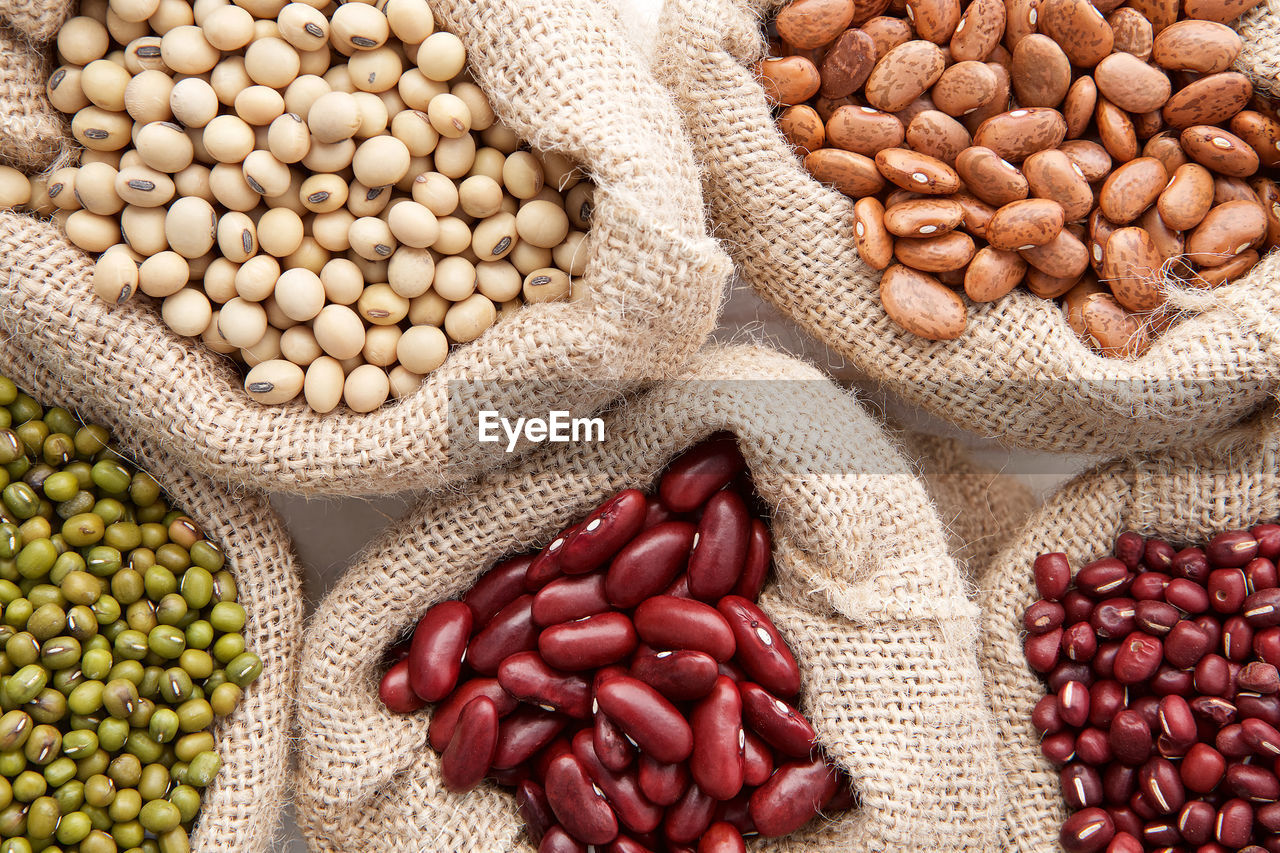 food, healthy eating, food and drink, large group of objects, freshness, bean, wellbeing, variation, abundance, choice, no people, vegetable, sack, high angle view, still life, fruit, legume family, seed, market, indoors