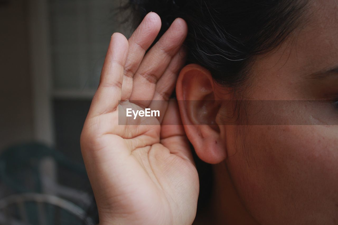 Cropped Image Of Woman Listening