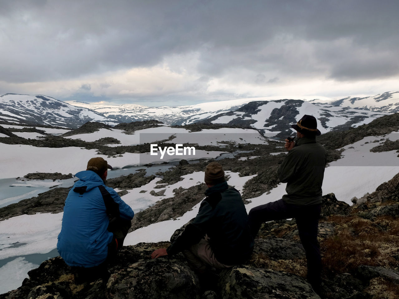 three hikers looking at scenery of Breheimen National Park in Norway where you can experience barren mountains, streaming rivers, opalescent glaciers and rough untouched nature. Breheimen National Park Norway Norway Nature Nature The Great Outdoors - 2018 EyeEm Awards Adventure Beauty In Nature Cold Temperature Looking Looking At View Men Mountain Range Nature Non-urban Scene Outdoor Photography Outdoors People Real People Rear View Watching Wilderness
