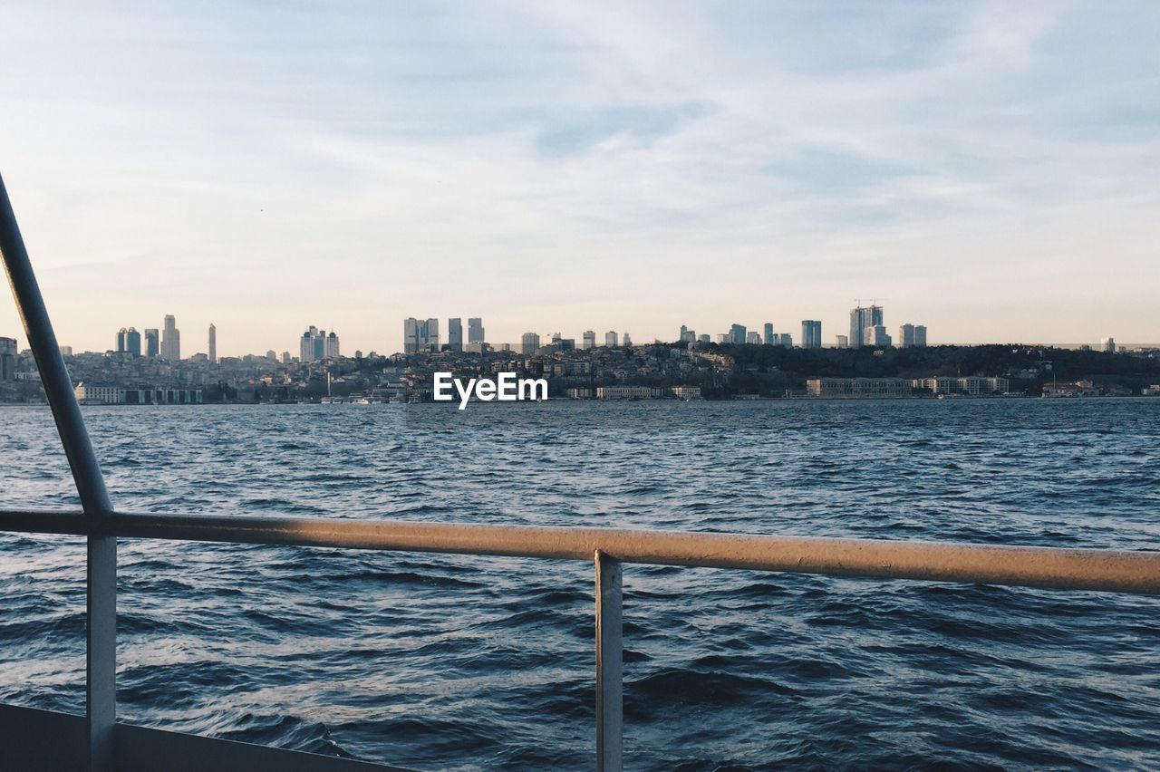 architecture, city, skyscraper, building exterior, cityscape, built structure, sea, sky, water, waterfront, no people, nautical vessel, outdoors, day, urban skyline, modern, sailing, nature
