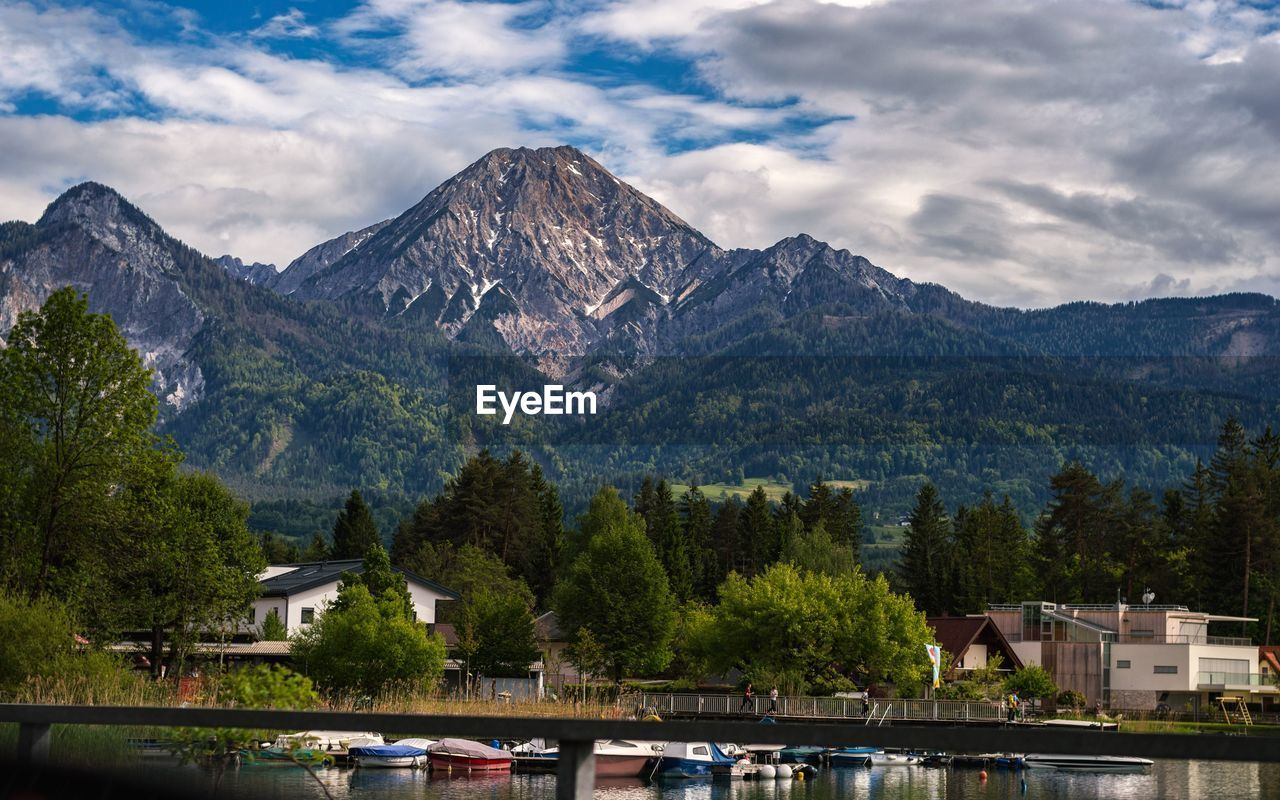 mountain, tree, building exterior, architecture, built structure, cloud - sky, mountain range, sky, house, outdoors, scenics, day, water, no people, nature, beauty in nature