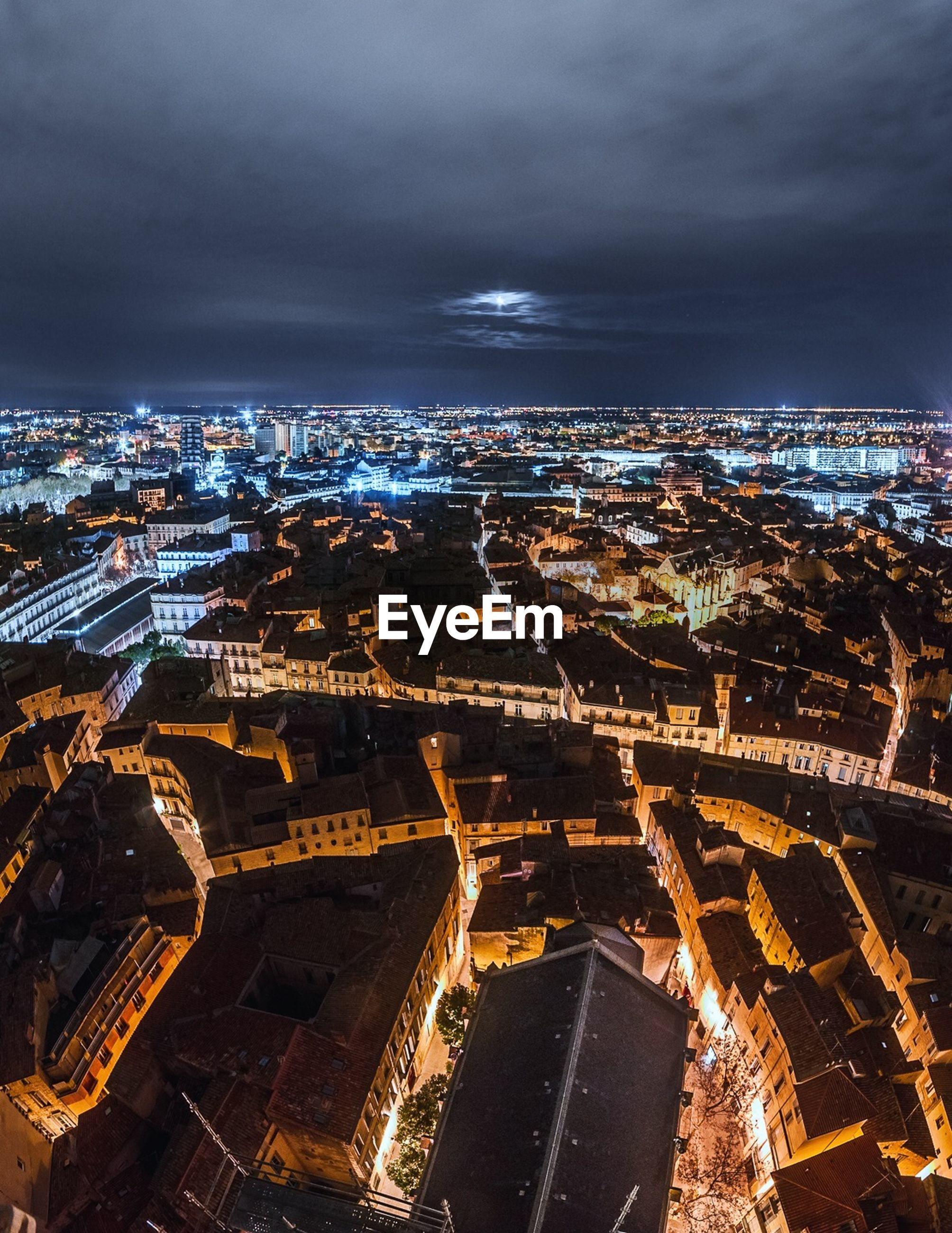 architecture, cityscape, built structure, city, building exterior, aerial view, high angle view, cloud - sky, no people, travel destinations, sky, illuminated, outdoors, night, nature