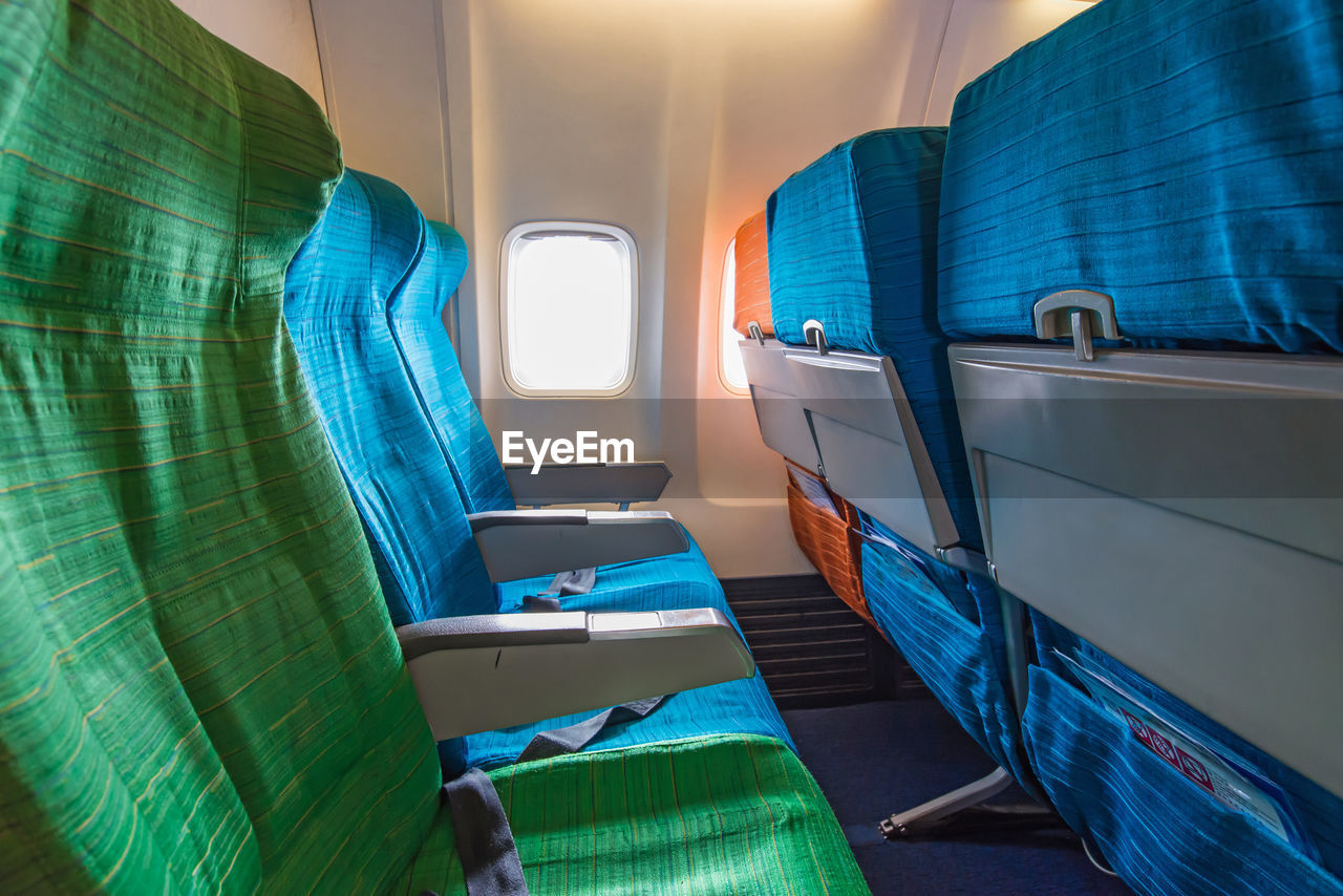 mode of transportation, transportation, vehicle seat, seat, vehicle interior, travel, nautical vessel, public transportation, window, journey, no people, airplane, absence, day, empty, air vehicle, blue, nature, airplane seat, water, outdoors, passenger craft, luxury