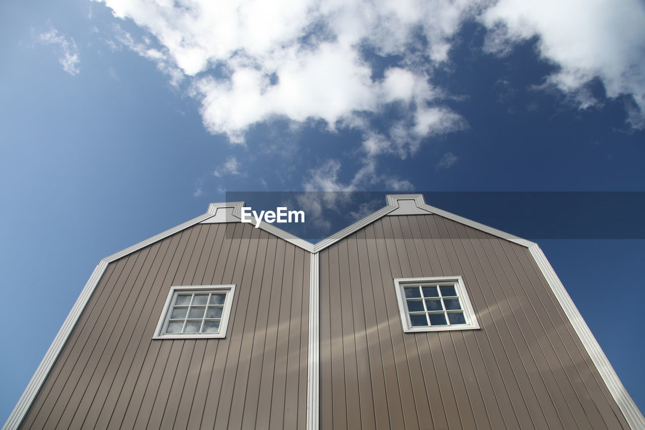Low Angle View Of Country Facade Against Blue Sky