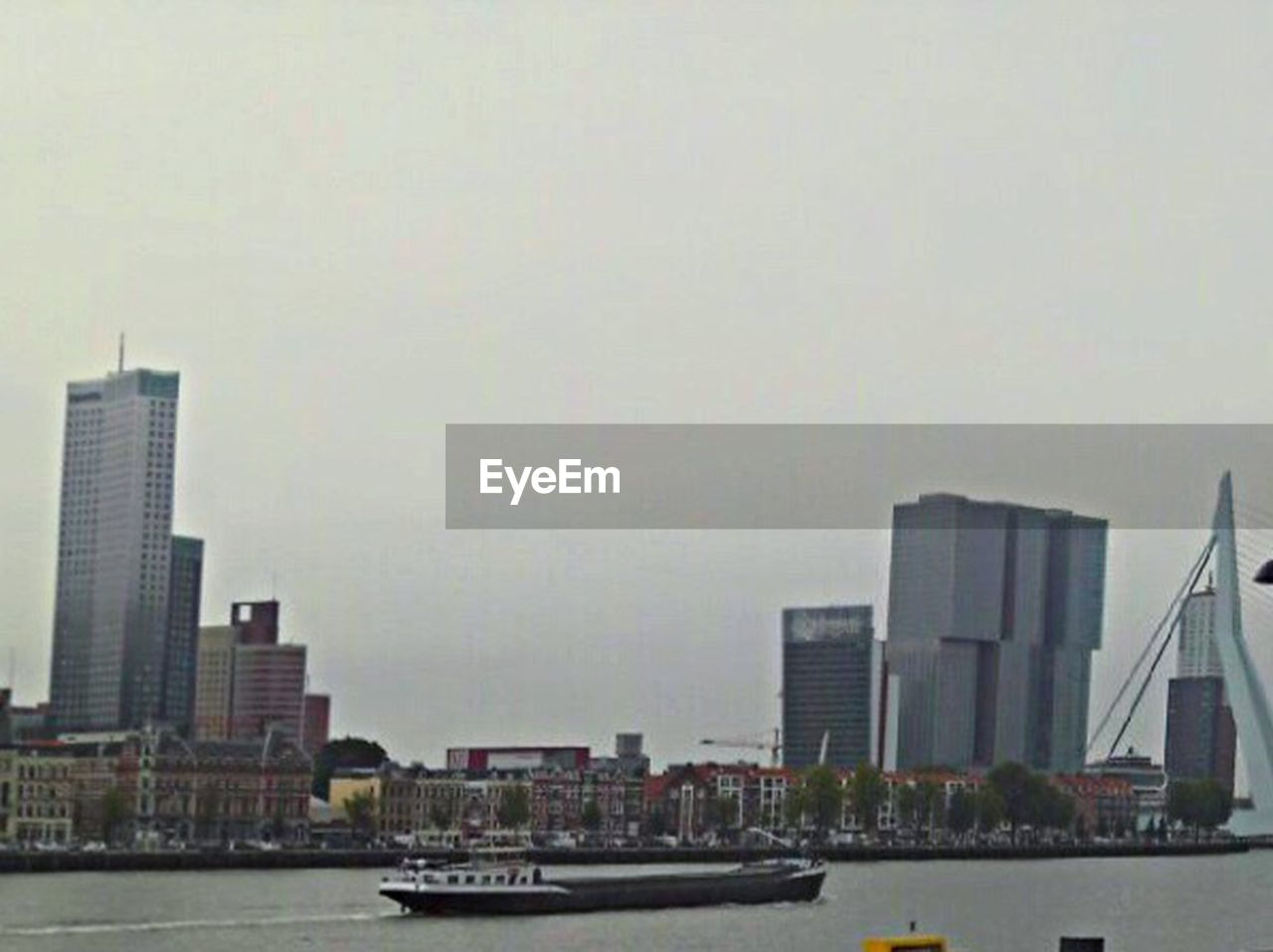 skyscraper, waterfront, city, architecture, building exterior, water, river, built structure, modern, cityscape, urban skyline, no people, outdoors, nautical vessel, day, sky