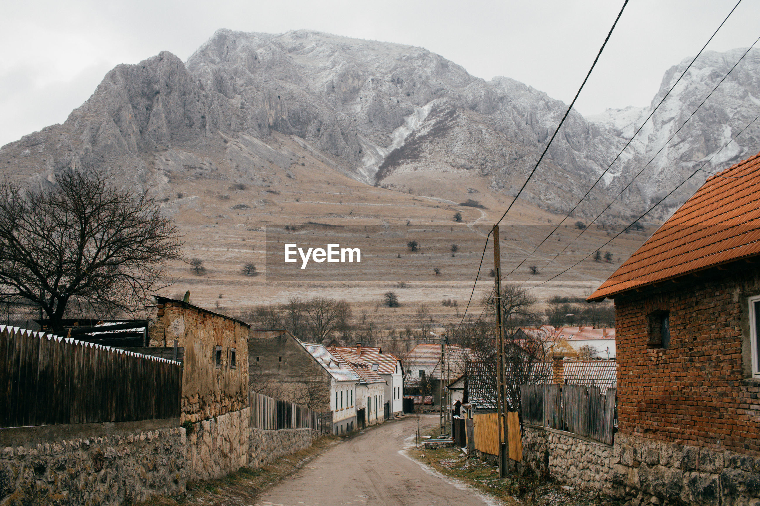 HOUSES AGAINST MOUNTAINS