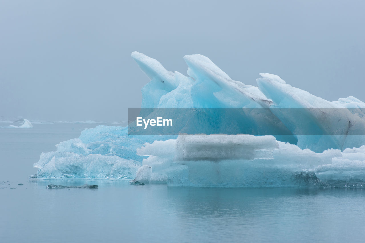 water, cold temperature, ice, winter, glacier, waterfront, snow, frozen, scenics - nature, beauty in nature, sky, sea, tranquil scene, tranquility, iceberg - ice formation, environment, nature, iceberg, no people, melting, outdoors, floating on water