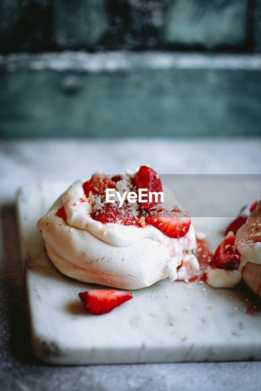 CLOSE-UP OF ICE CREAM WITH STRAWBERRIES