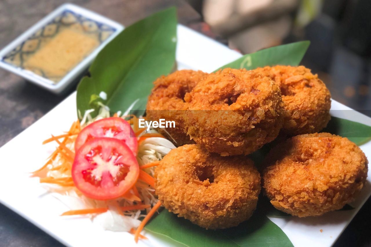 food and drink, food, freshness, ready-to-eat, plate, close-up, serving size, no people, indoors, fried, still life, focus on foreground, meat, appetizer, healthy eating, deep fried, high angle view, leaf, wellbeing, indulgence, snack, temptation, fried chicken