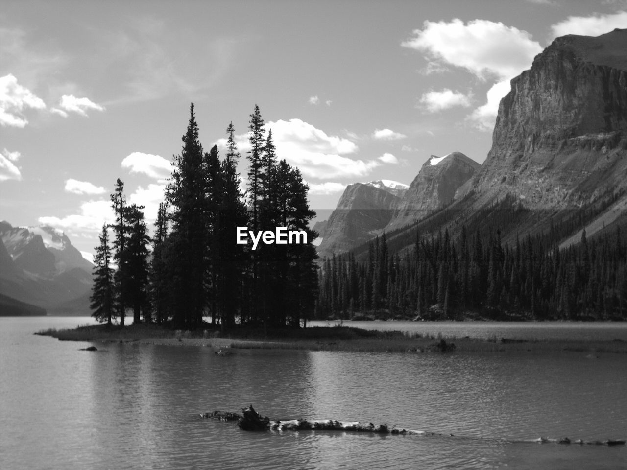 Maligne Lake In Front Of Rocky Mountains And Silhouette Trees Against Sky