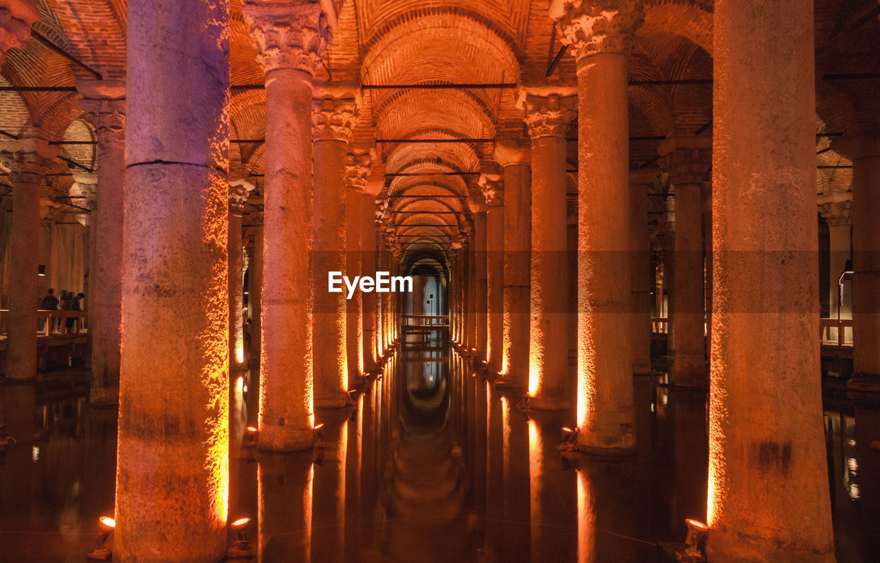 architecture, built structure, indoors, architectural column, building, history, arch, the past, place of worship, no people, travel destinations, pipe - tube, religion, tourism, belief, metal, spirituality, ancient, travel, illuminated, aisle