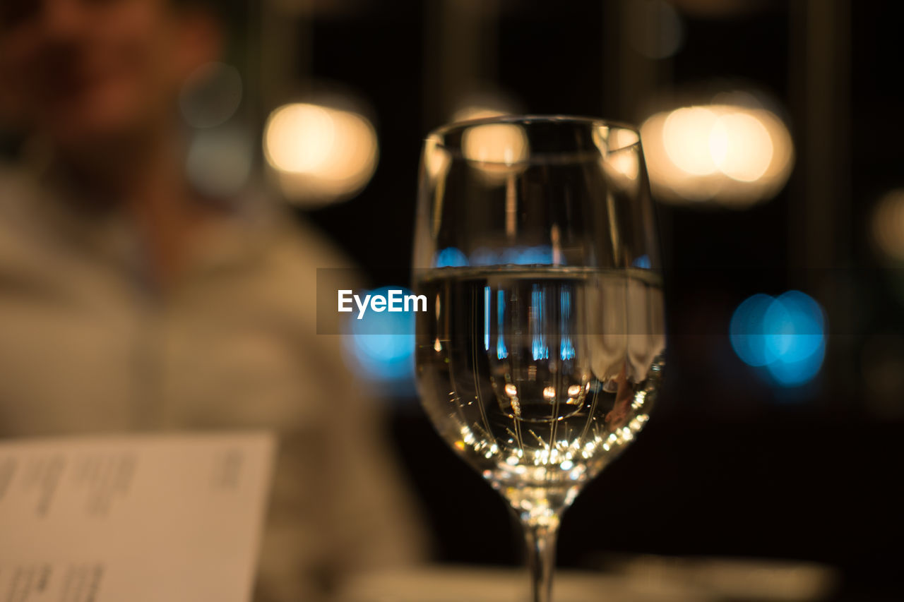 Close-up of wineglass at restaurant