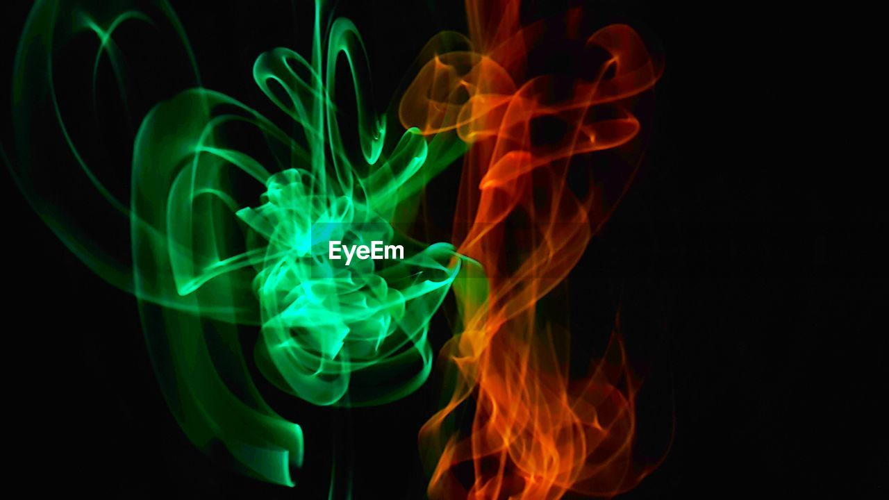 black background, burning, close-up, green color, flame, illuminated, no people, motion, night, indoors