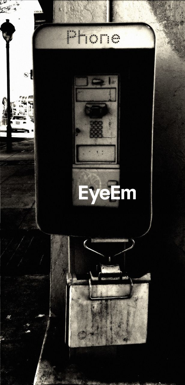 Close-up of an old pay phone outdoors