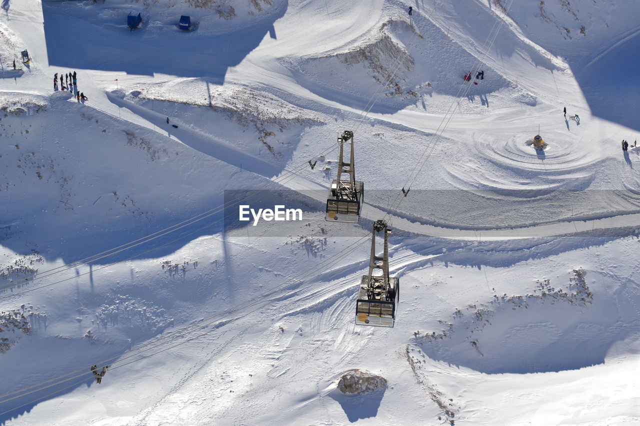 High Angle View Of Ski Lift Over Snowcapped Mountains