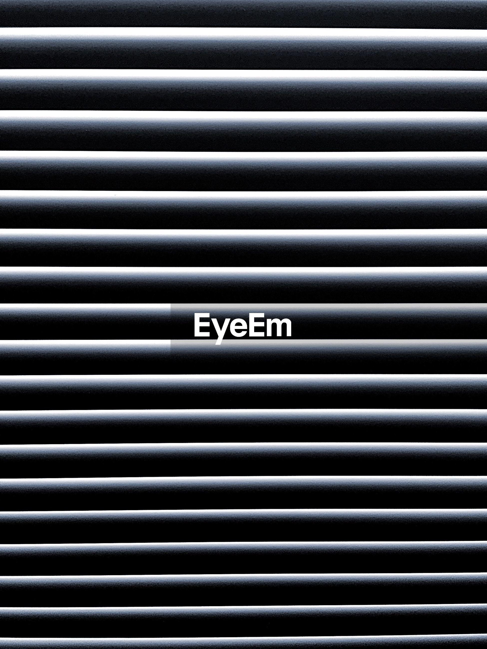 Full frame shot of blinds on window