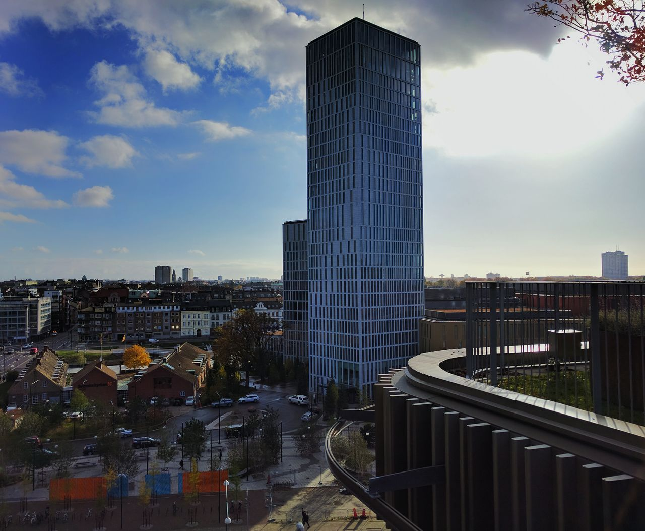 architecture, building exterior, built structure, city, sky, modern, skyscraper, cloud - sky, cityscape, outdoors, no people, day, urban skyline, tree