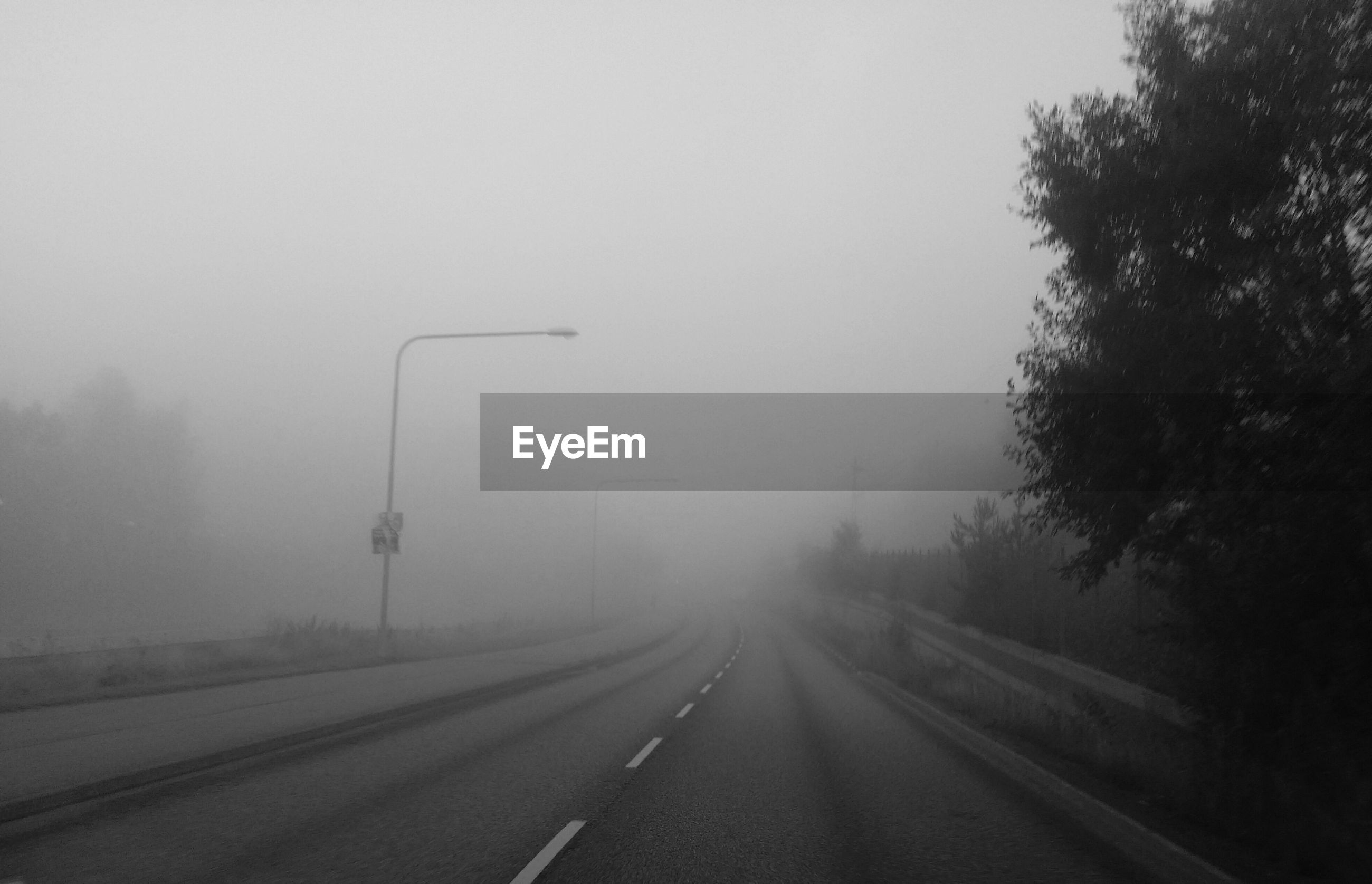 View of empty road in fog