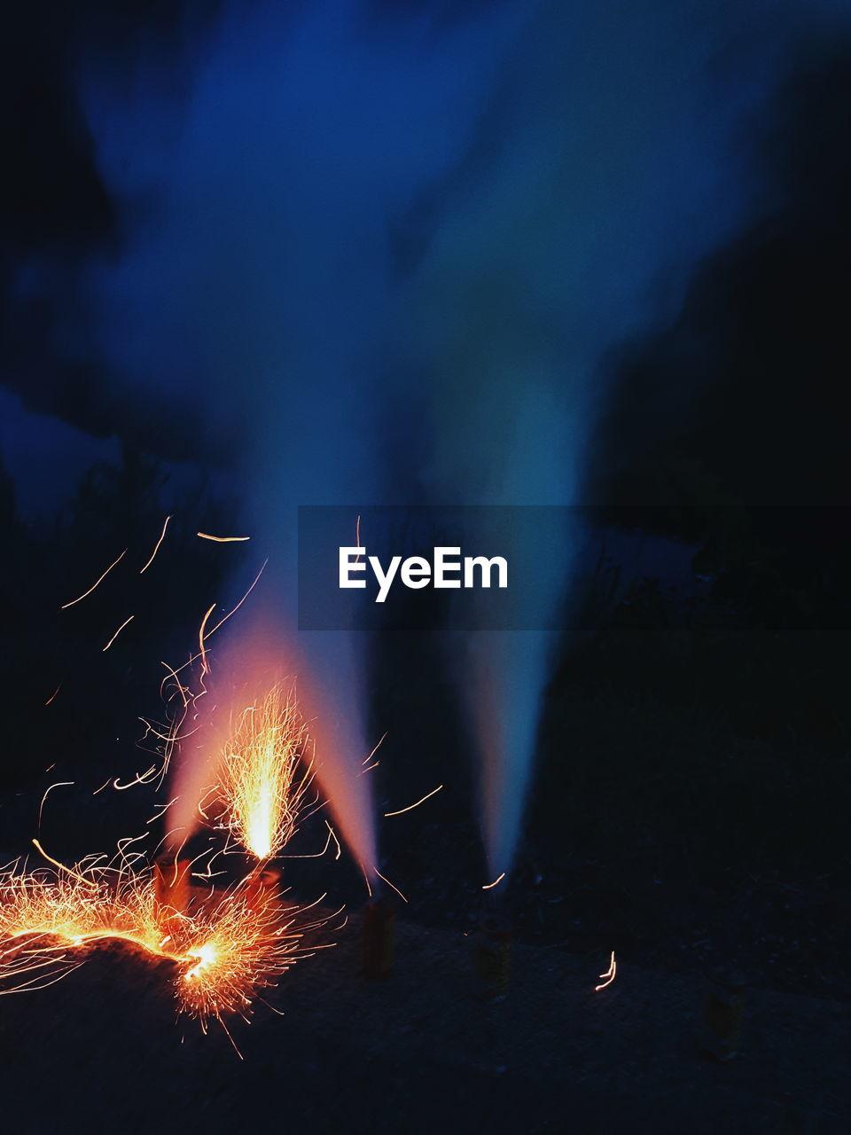 FIREWORK DISPLAY AGAINST SKY