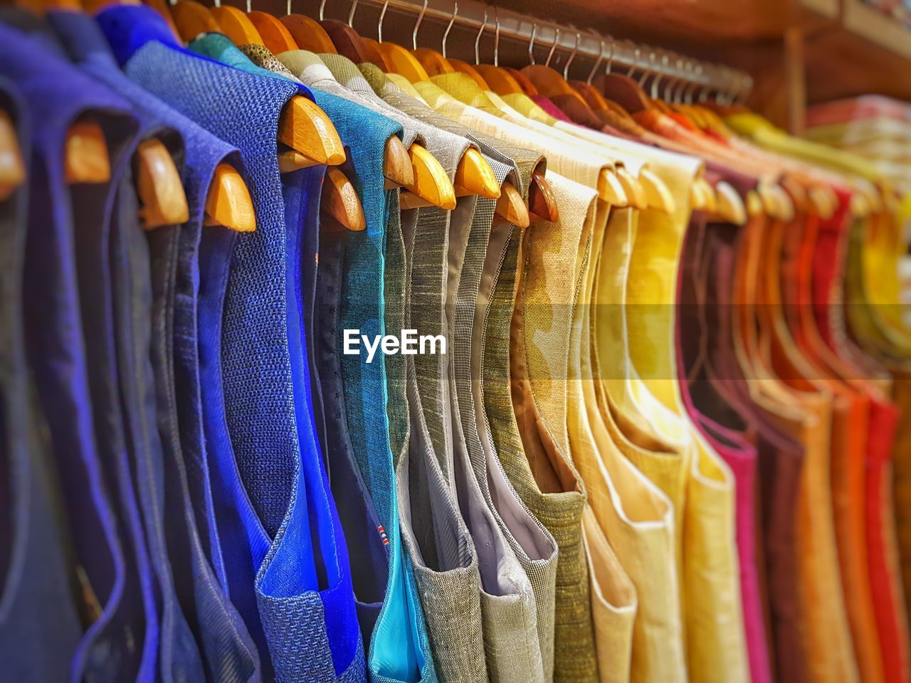Full frame shot of multi colored jackets hanging in store
