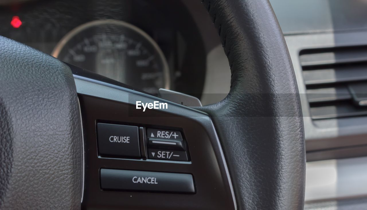 vehicle interior, car interior, transportation, car, mode of transport, land vehicle, vehicle seat, text, dashboard, steering wheel, seat, travel, no people, close-up, indoors, day, technology, speedometer, control panel