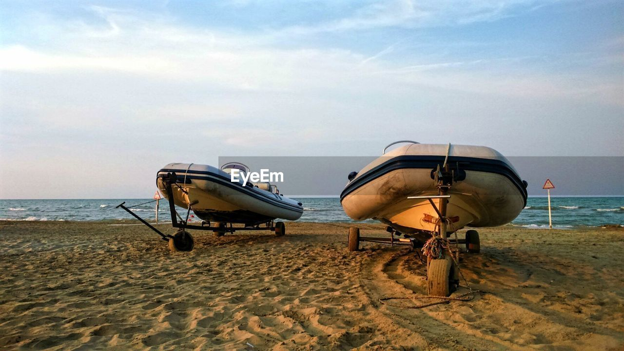 sand, beach, sea, sky, transportation, mode of transport, nature, air vehicle, outdoors, day, cloud - sky, vacations, horizon over water, no people, water, scenics, beauty in nature, airplane