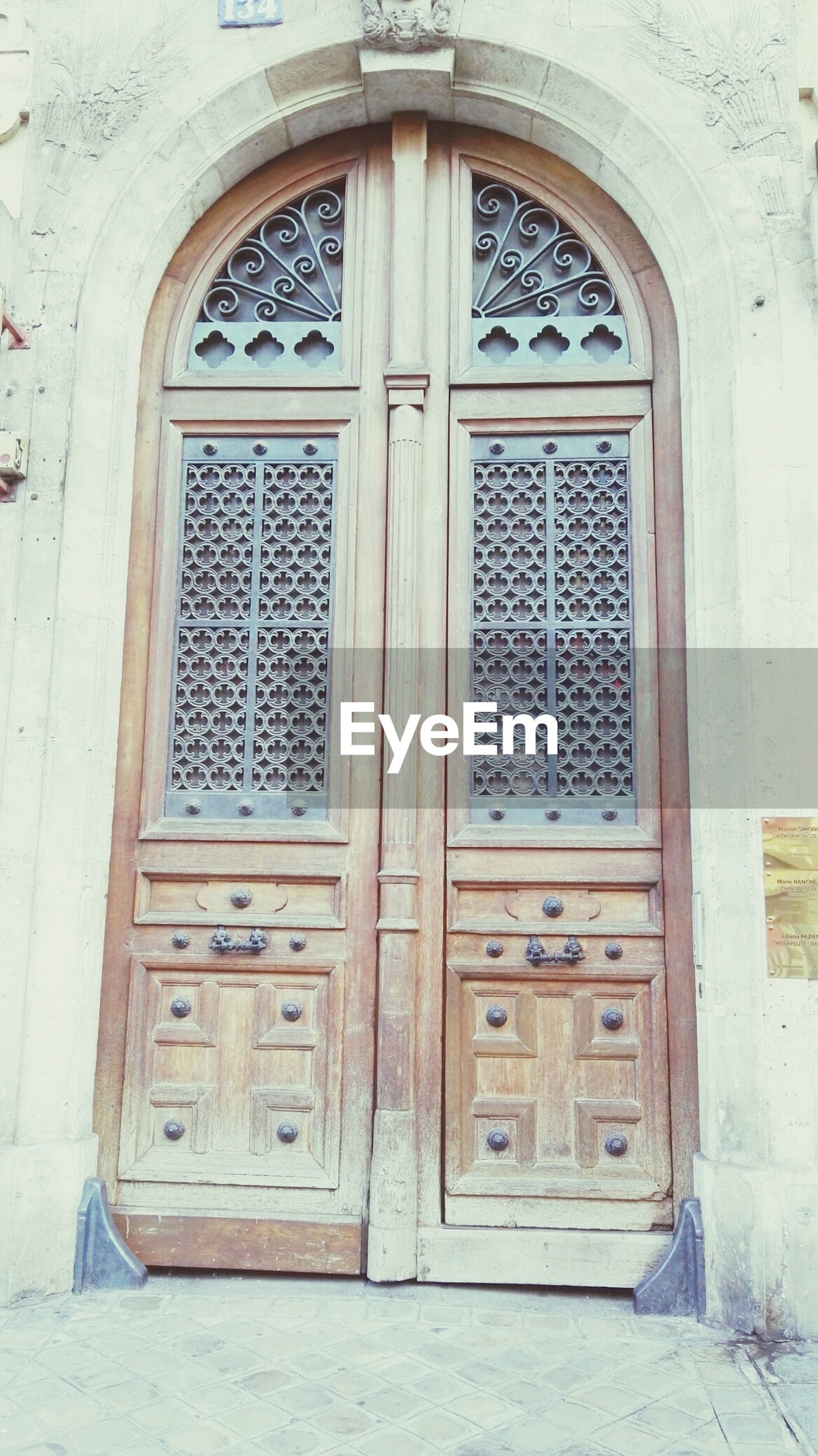 door, closed, architecture, built structure, entrance, building exterior, window, arch, safety, house, protection, wood - material, doorway, old, closed door, security, day, front door, facade, ornate