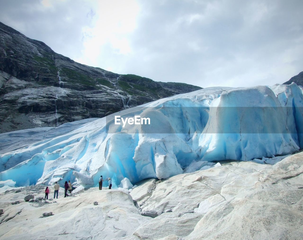 Scenic view of big ice berg against blue clear sky