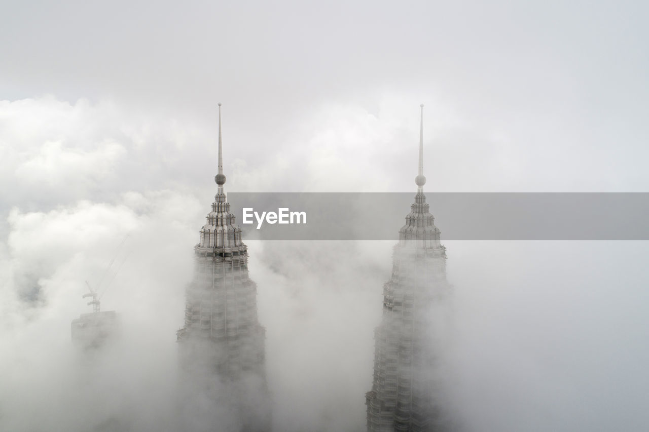 Skyscraper amidst clouds