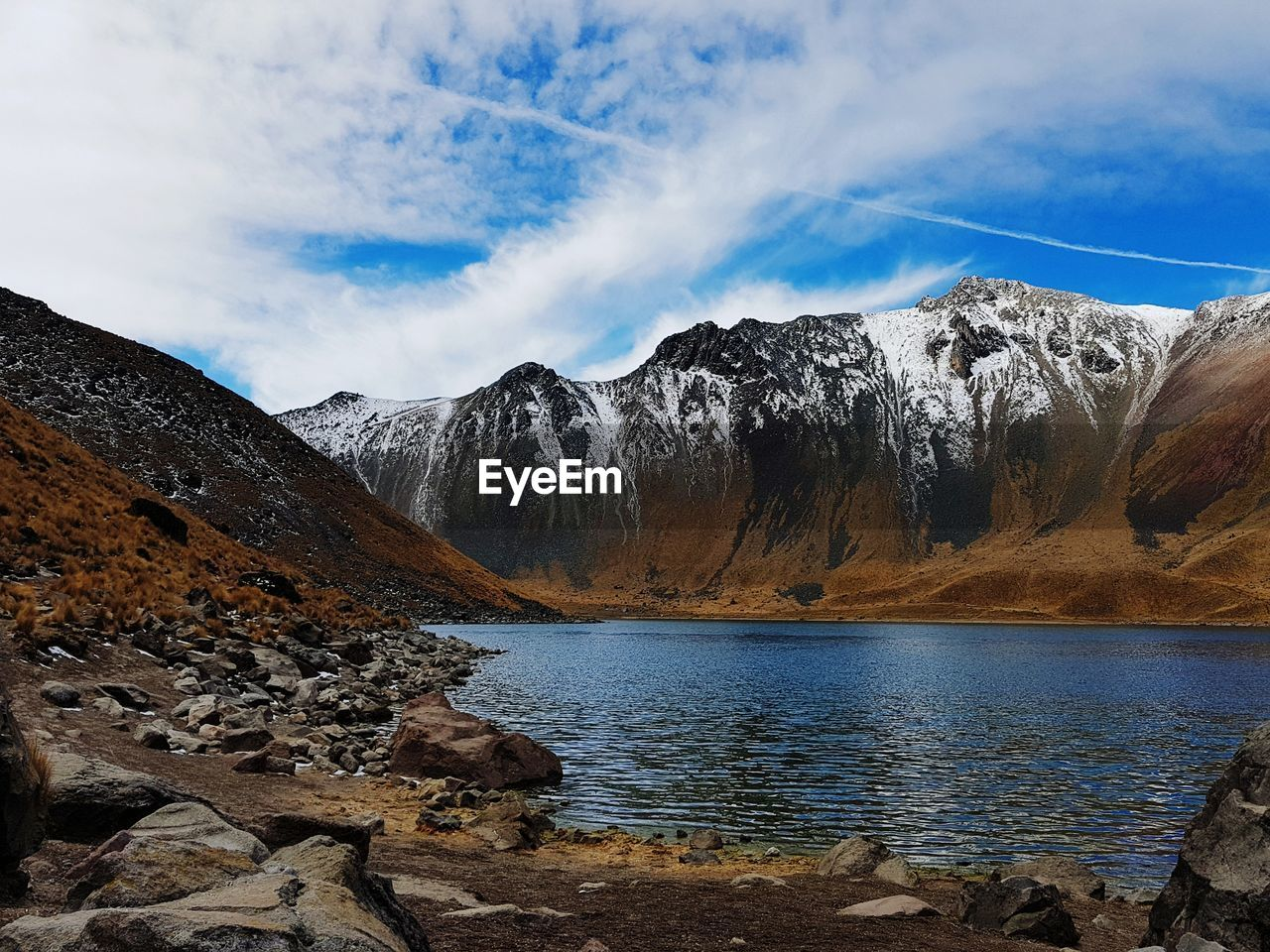 sky, scenics - nature, mountain, beauty in nature, water, tranquility, tranquil scene, cloud - sky, non-urban scene, rock, mountain range, nature, idyllic, solid, rock - object, no people, lake, winter, day, snowcapped mountain, formation, mountain peak