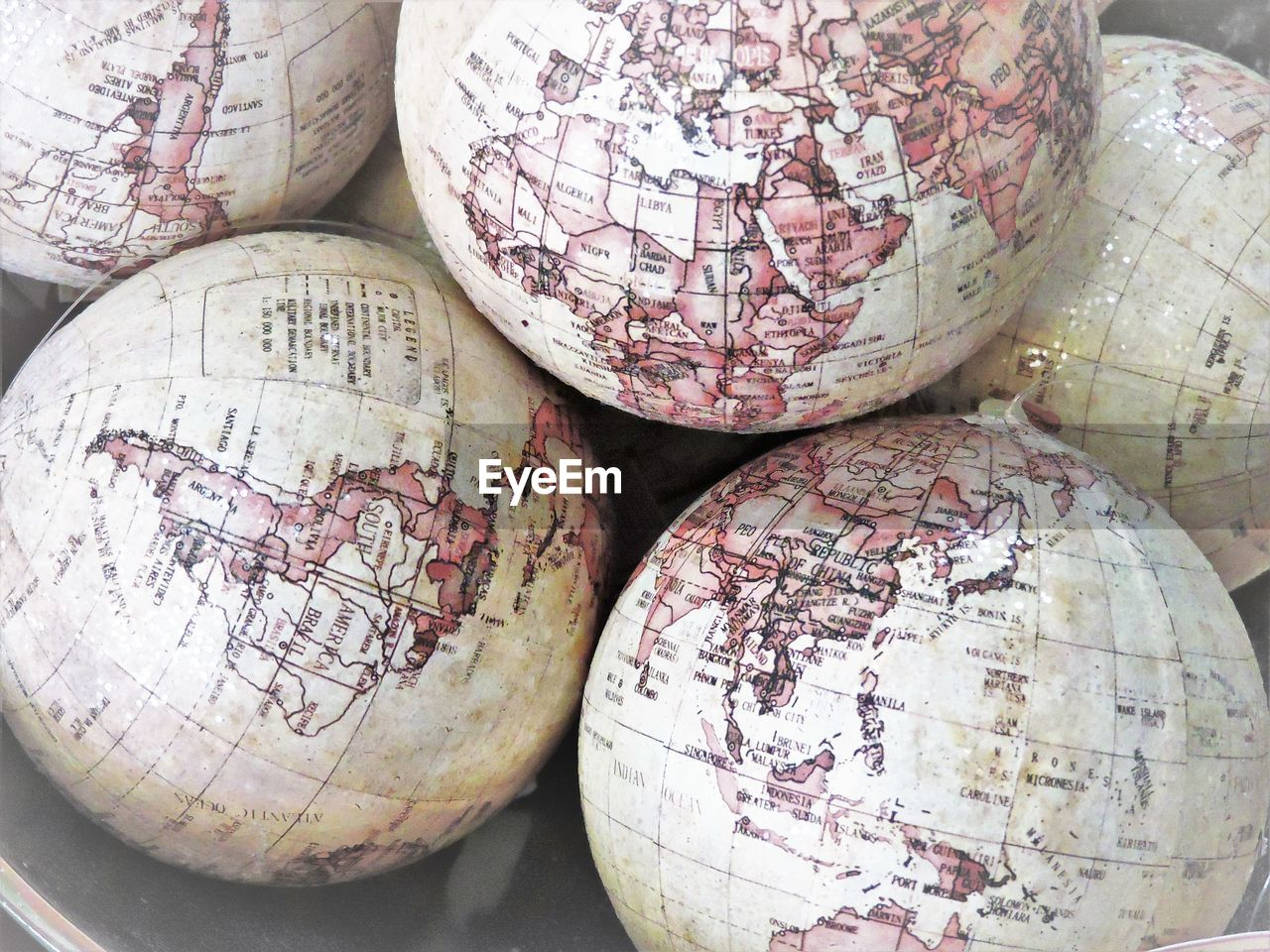 High angle view of damaged globes on table
