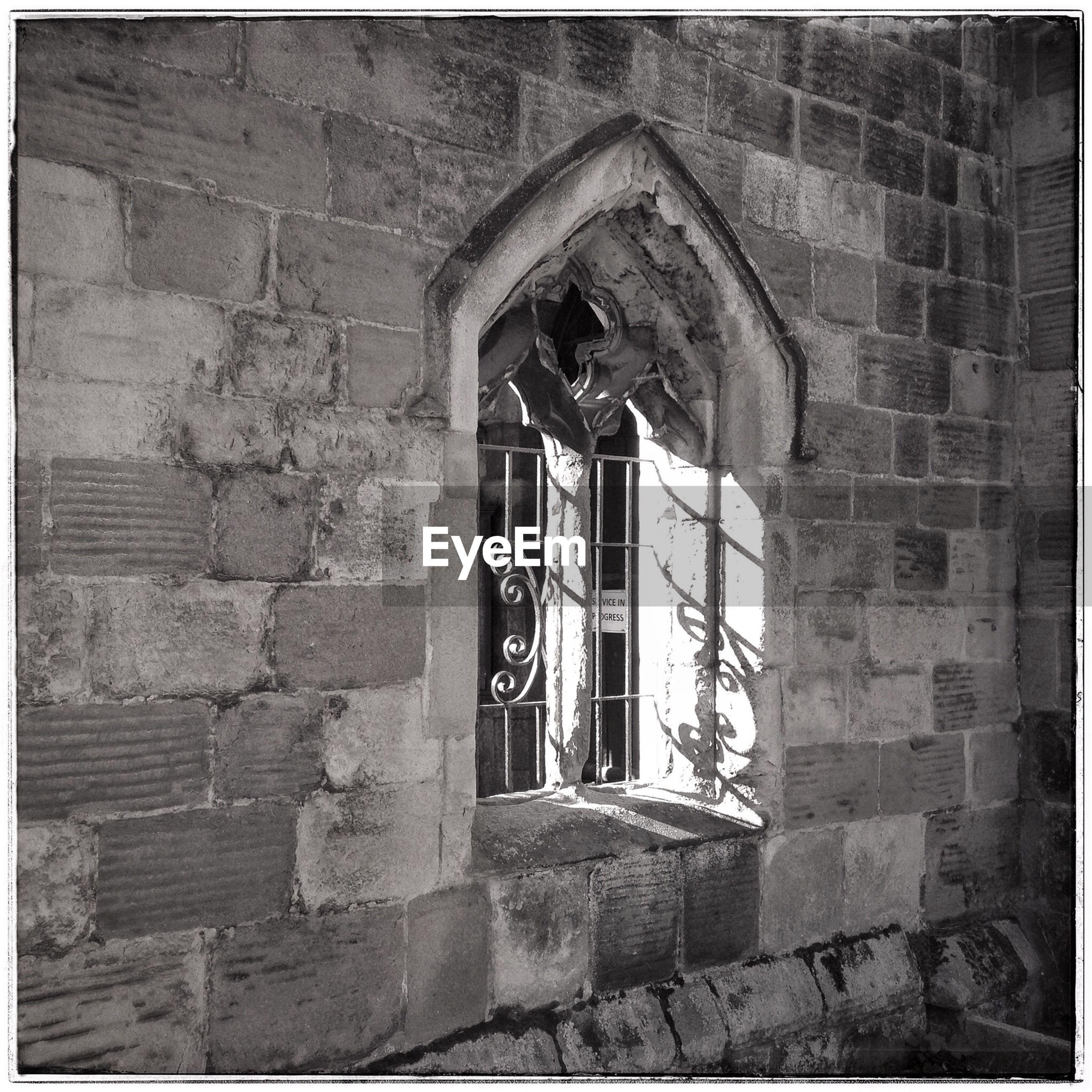 EXTERIOR OF HISTORIC CHURCH SEEN THROUGH ARCH