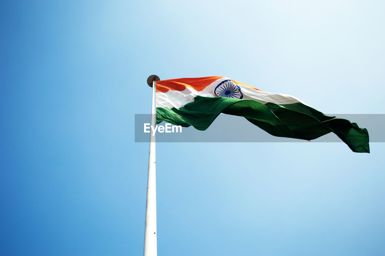 Low angle view of indian flag against clear sky