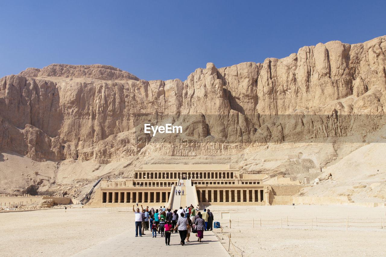 Tourists Walking Towards Temple Of Hatshepsut
