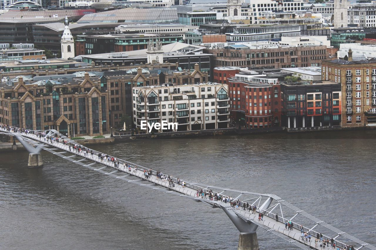 High Angle View Of People Walking On London Millennium Footbridge Over Thames River