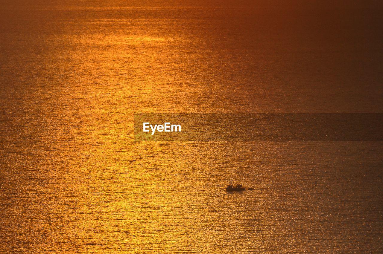 FULL FRAME SHOT OF SEA AT SUNSET