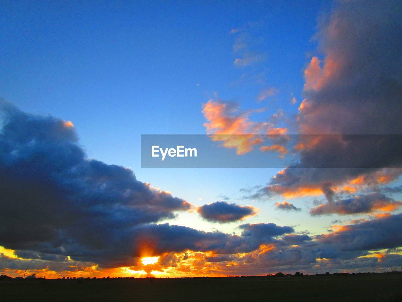 sky, cloud - sky, beauty in nature, scenics - nature, sunset, orange color, tranquility, tranquil scene, no people, nature, low angle view, outdoors, sunlight, idyllic, silhouette, environment, non-urban scene, blue, dramatic sky, majestic