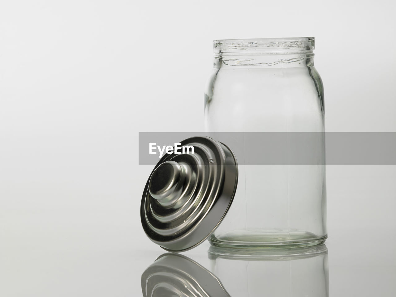 Close-up of empty glass bottle against white background