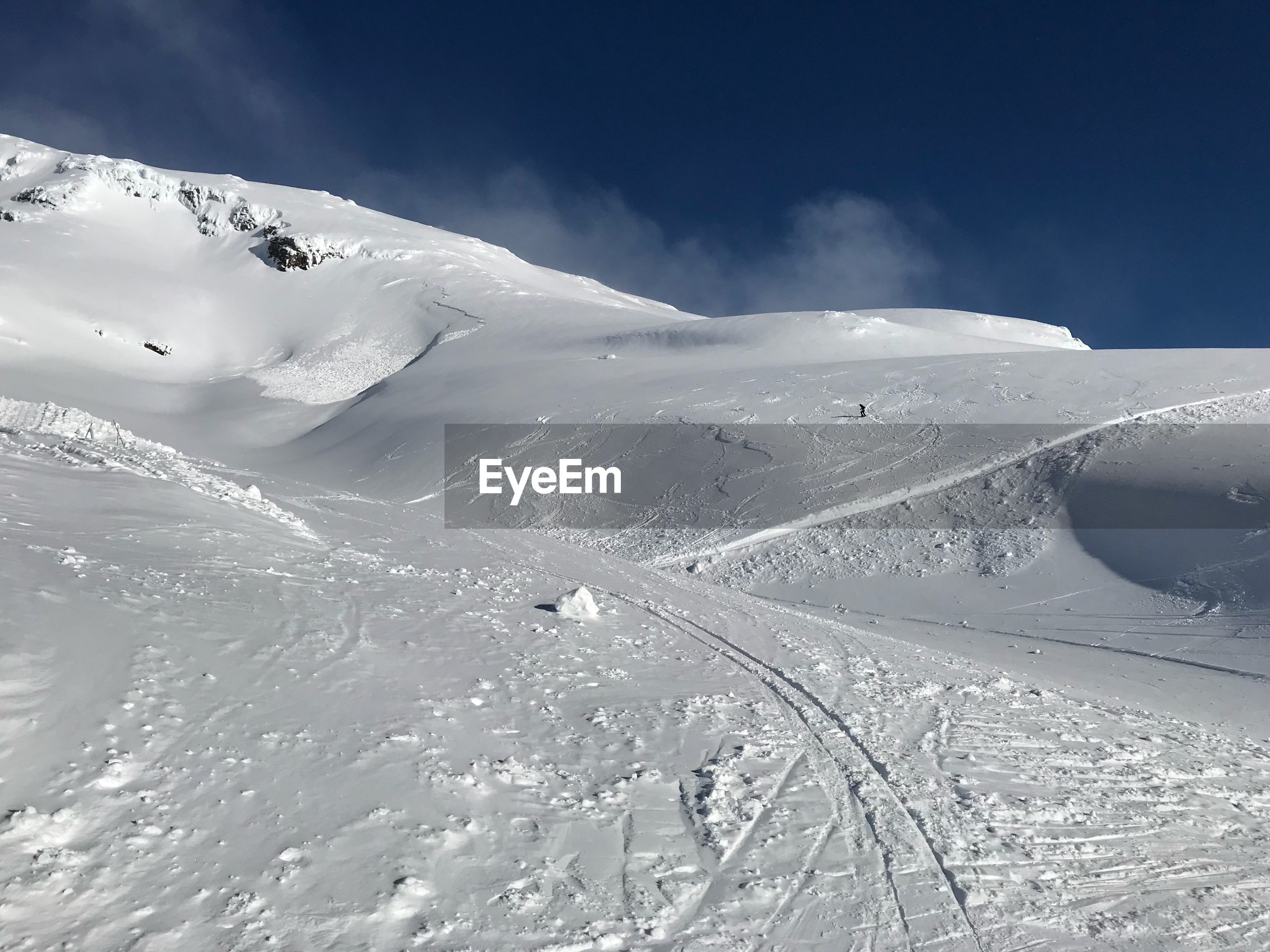 Scenic view of snow covered mountain against sky