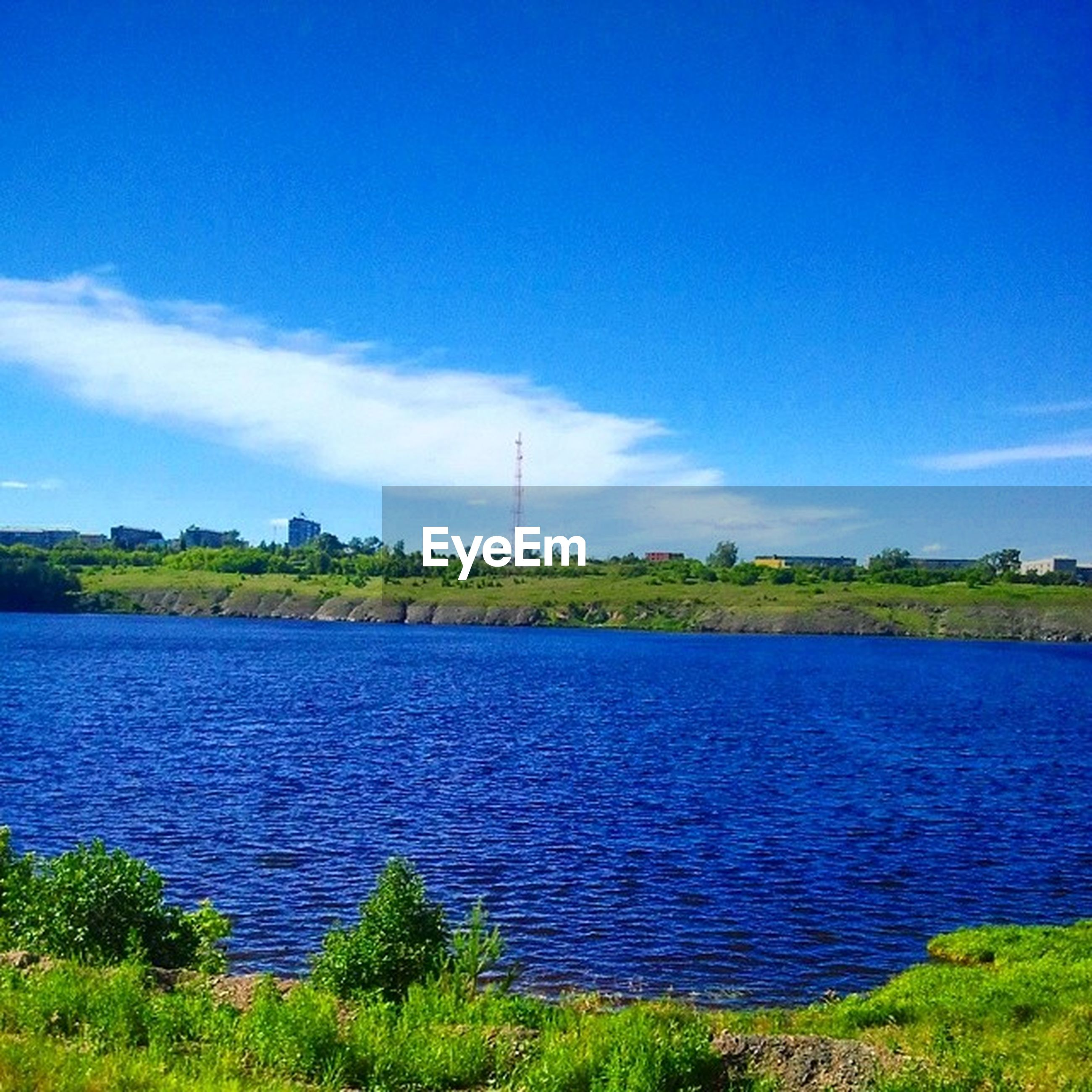 blue, tranquil scene, tranquility, water, grass, sky, scenics, beauty in nature, nature, landscape, green color, idyllic, cloud, tree, field, lake, plant, growth, green, countryside