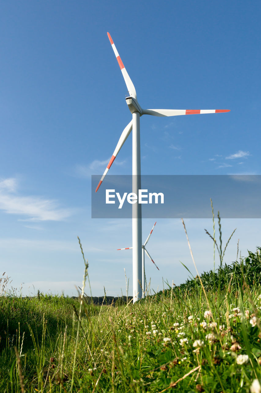 alternative energy, wind turbine, turbine, environmental conservation, renewable energy, fuel and power generation, field, grass, environment, sky, wind power, land, plant, nature, landscape, beauty in nature, green color, day, no people, rural scene, outdoors, sustainable resources